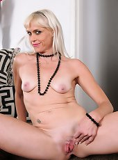 Lingerie solo scenes with a hairy milf in heats