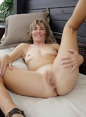 Sweet milf feels amazing while posing her nude forms